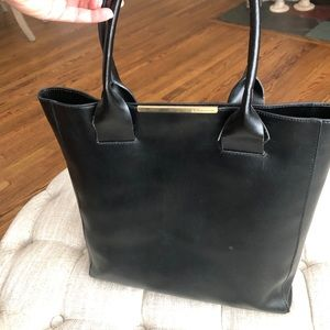 BCBG black computer bag with gold accent